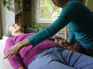 Jennifer Frick, Portland, Maine, applying Polarity to a client.